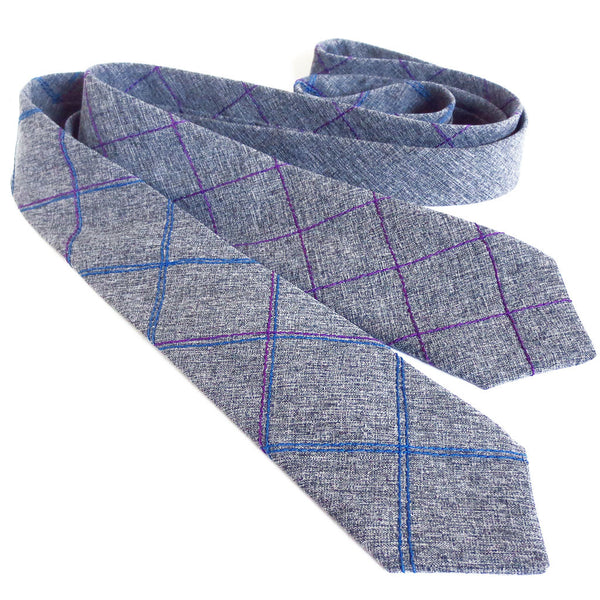 two handmade neckties from Holland Cox in gray wool blend suiting with stitched details in blue and purple
