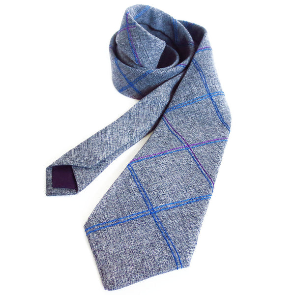 handmade necktie in wool/rayon blend suiting with purple and blue stitched details