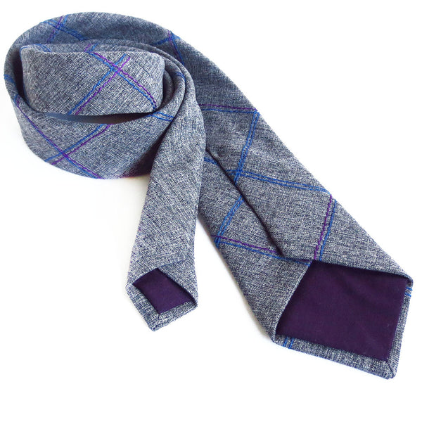 the kennedy necktie from Holland Cox is lined in purple