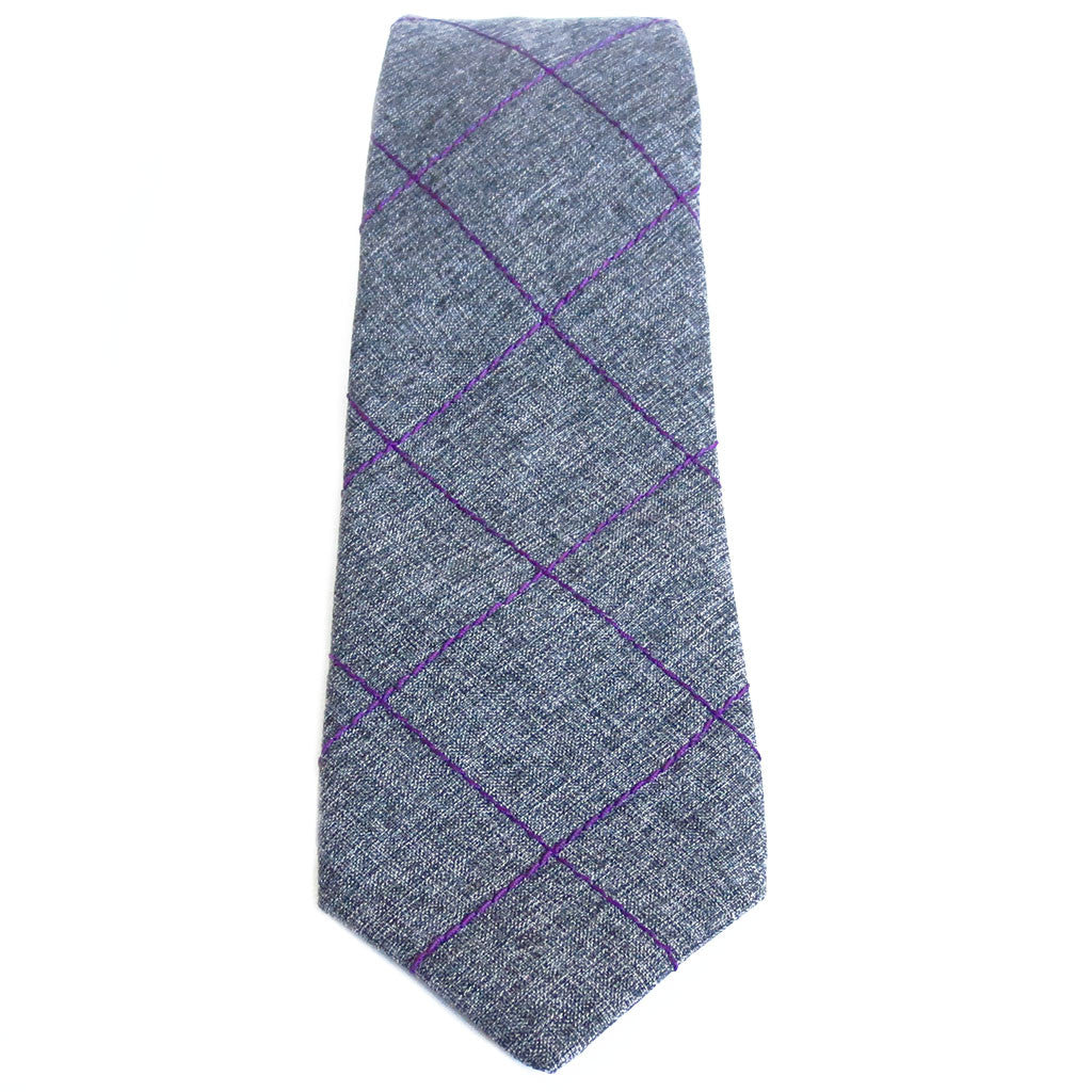 purple windowpane check stitched into gray wool blend suiting