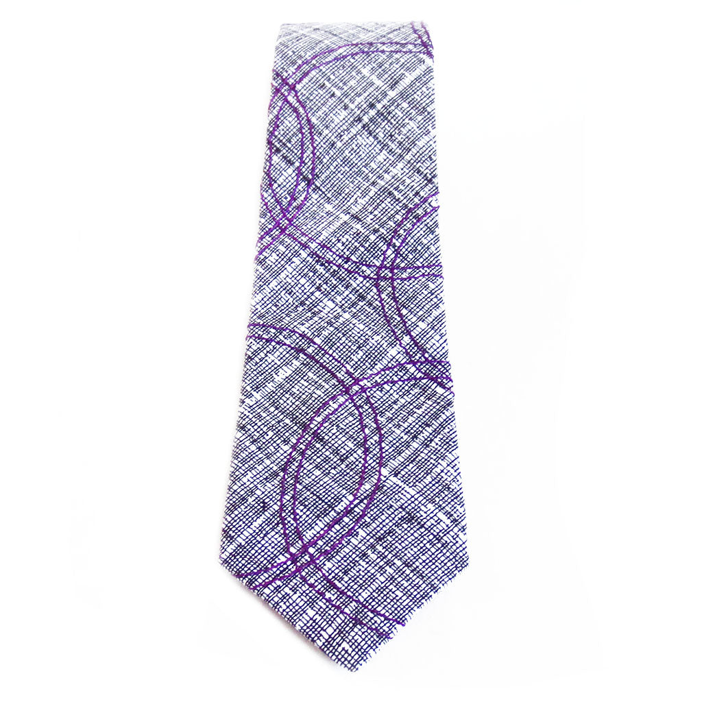 Cotton necktie in black and white print with purple circles stitched on top.