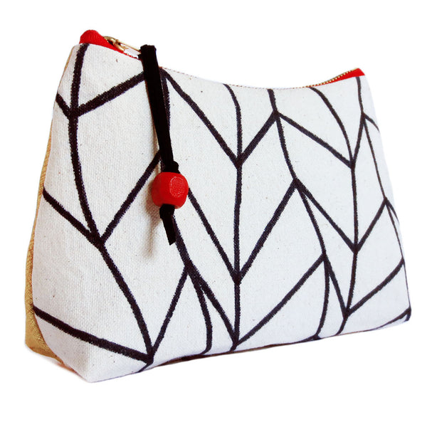 side view of the cassandra perfect pouch from Holland Cox