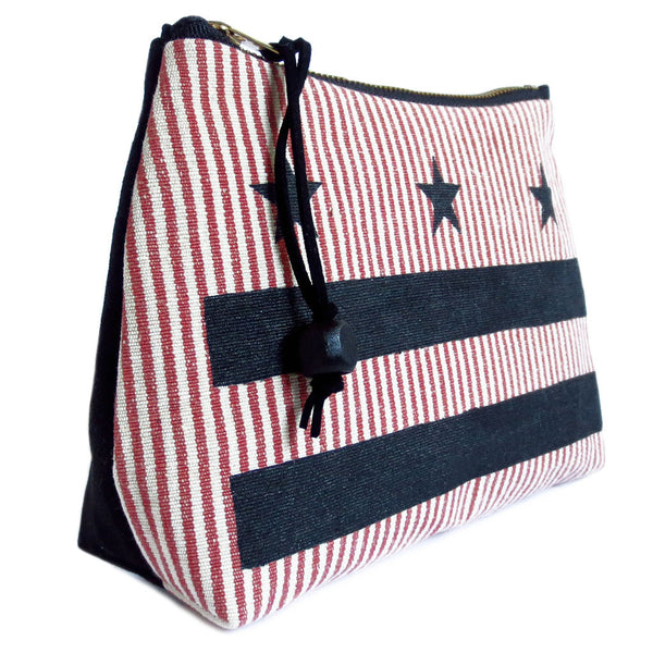 zipper pouch featuring the Washington DC flag stenciled in black