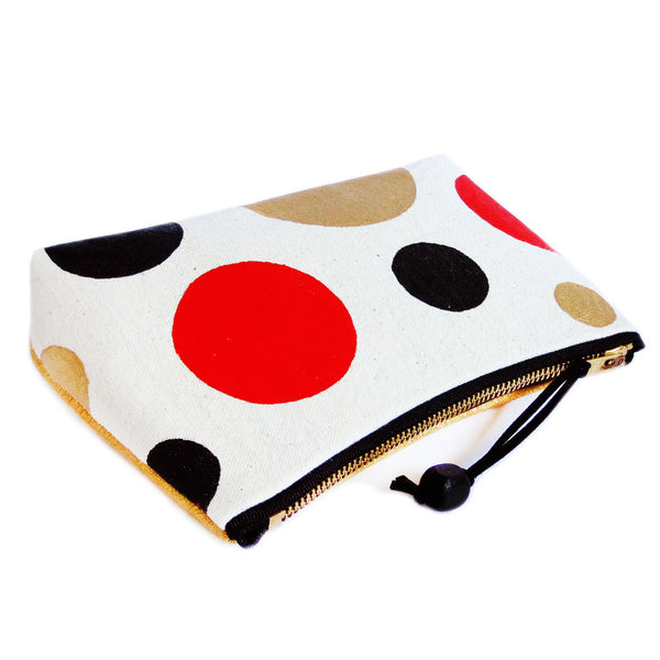 "hand painted polka dots zip pouch closes with 7"" zipper"
