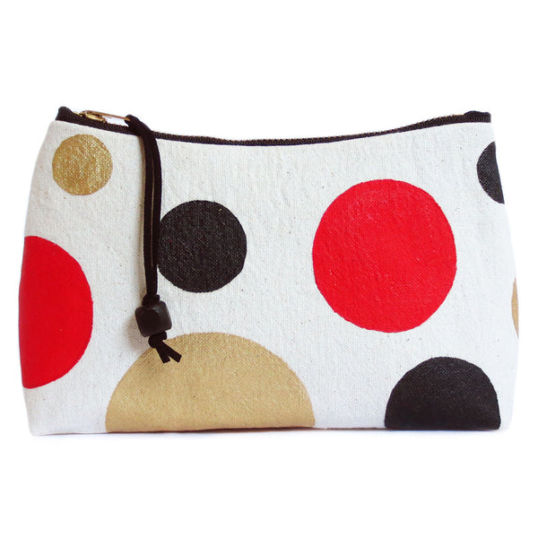 "gold leather and painted polka dot canvas zip pouch, 7"" brass zipper, black twill lining, black wooden bead pull"