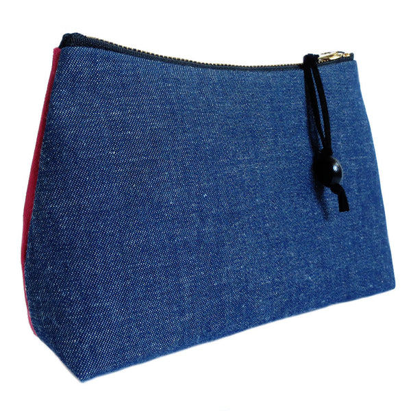 the back of the persephone zip pouch is vintage dark blue denim
