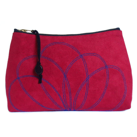 red ultrasuede zip pouch with stitched petal motif, from Holland Cox