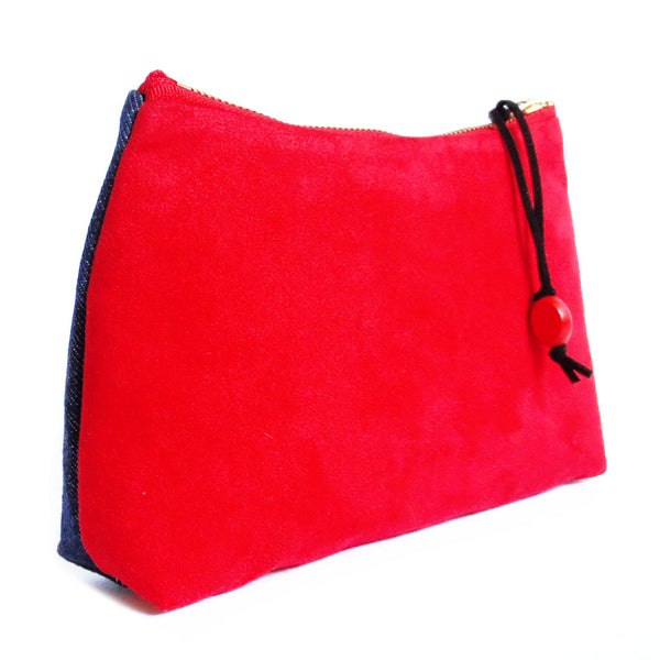 the back of the simone zip pouch is bright red ultra suede