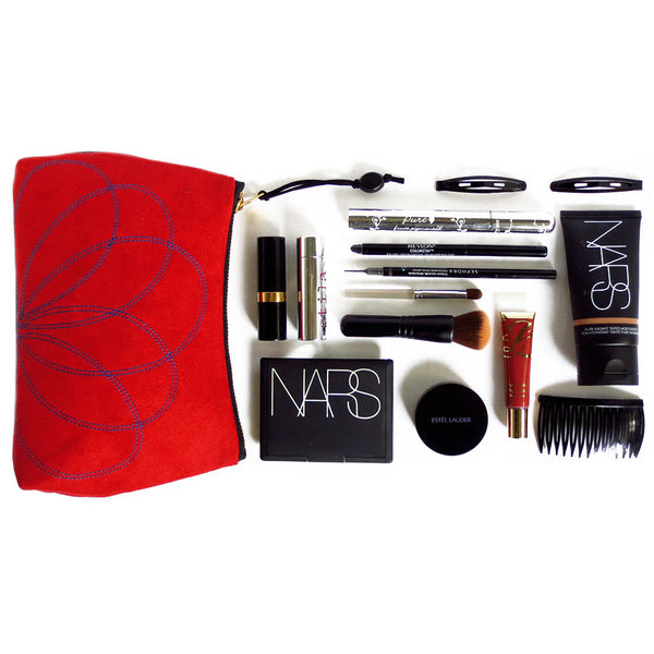 "an idea of what can fit inside your 7"" perfect pouch...all your essential makeup plus a few just-in-case items, for starters!"