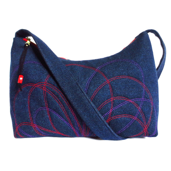 denim handbag with petal motif stitched in red and purple