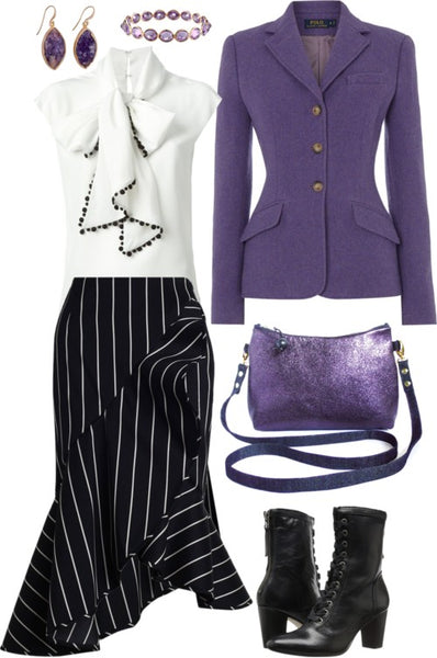 the reina crossbody bag styled for work, with a purple blazer, a pinstriped skirt, and a white ruffly top