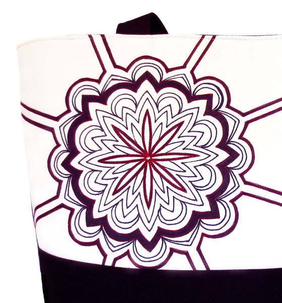 close up of the hand drawn mandala stitched with red on the regina tote from Holland Cox