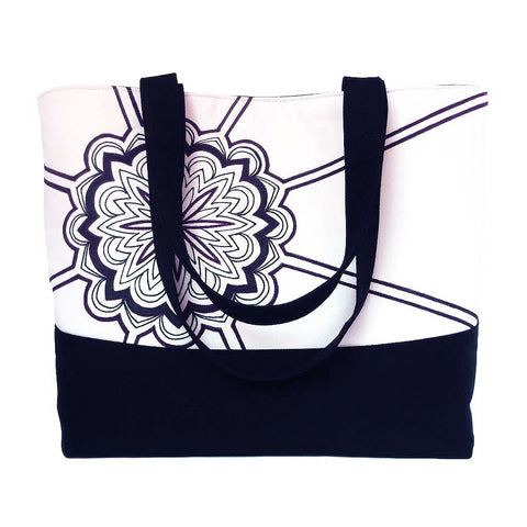 black denim tote bag featuring a mandala-style motif hand drawn in black ink, and accented with red stitching