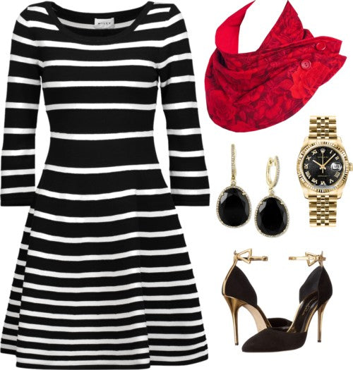 the rosetta scarf styled with a black and white striped dress, black heels, and black and gold jewelry