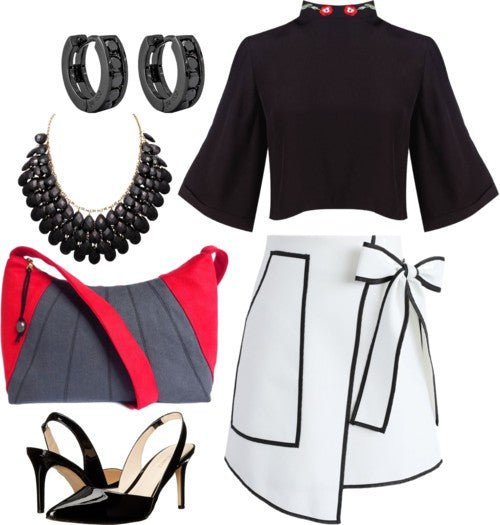 outfit idea for the sibyl everyday bag, featuring a black top and a black and white wrap skirt