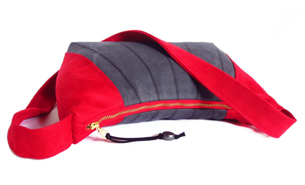 "the sibyl bag closes with a 12"" red zipper with brass teeth"