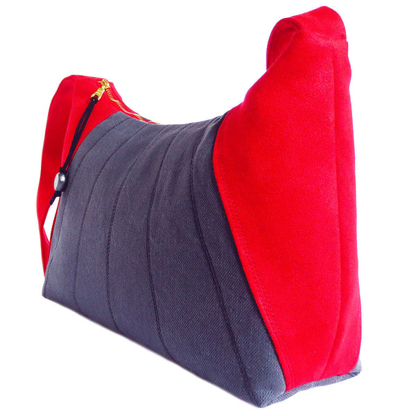side view of the sibyl everyday bag, showing off the bright red ultrasuede