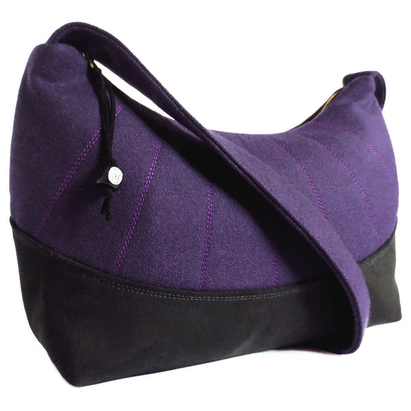 the simone everyday bag features purple wool with stitching details and black ultrasuede
