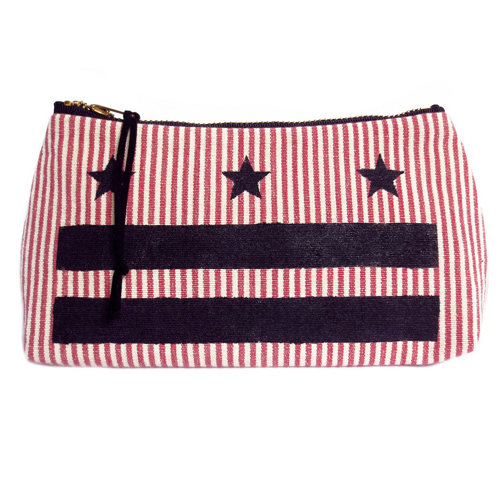 small pouch from Holland Cox featuring the stars and bars of the DC flag painted in black on vintage red and white ticking