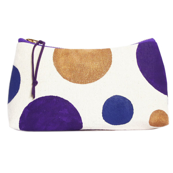 small zip pouch from Holland Cox hand painted with polka dots in gold, purple, and blue