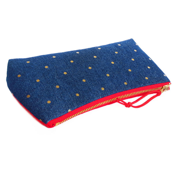 "the small pouch closes with a 7"" heavy duty brass zipper"