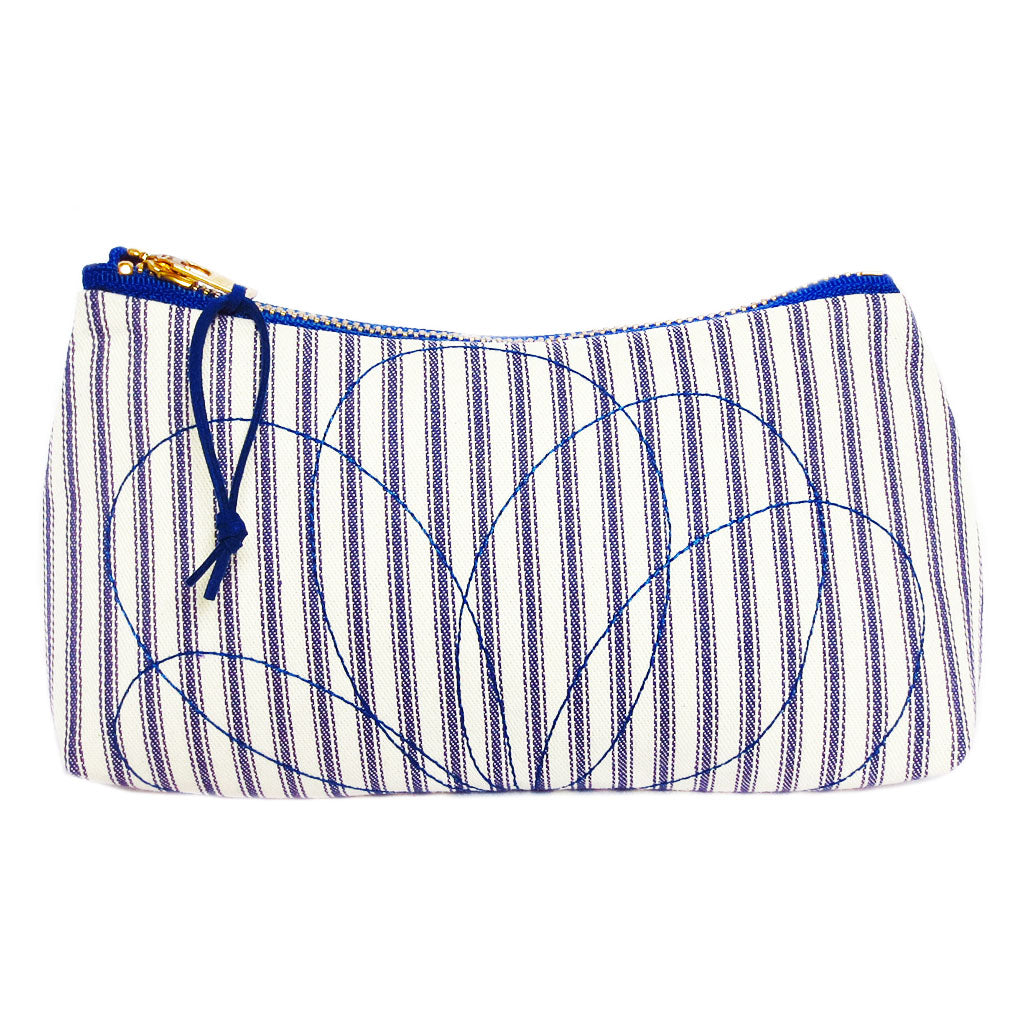 small zip pouch with petal motif stitched on blue and white ticking