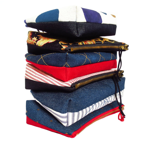 stack of small perfect pouches from Holland Cox