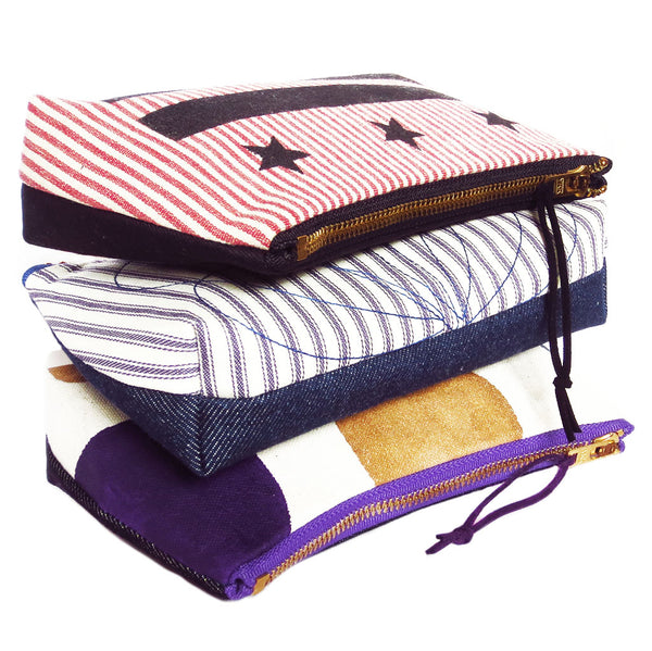 the stars and bars, persephone, and felicity small perfect pouches from Holland Cox