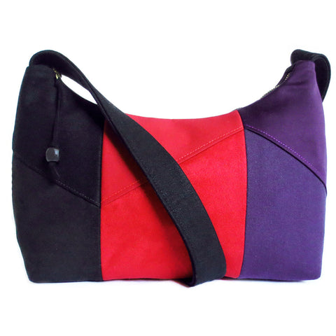 The trinity everyday bag from Holland Cox, in black, red, and purple