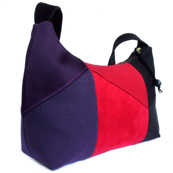 side view of the trinity everyday bag, showing the purple side
