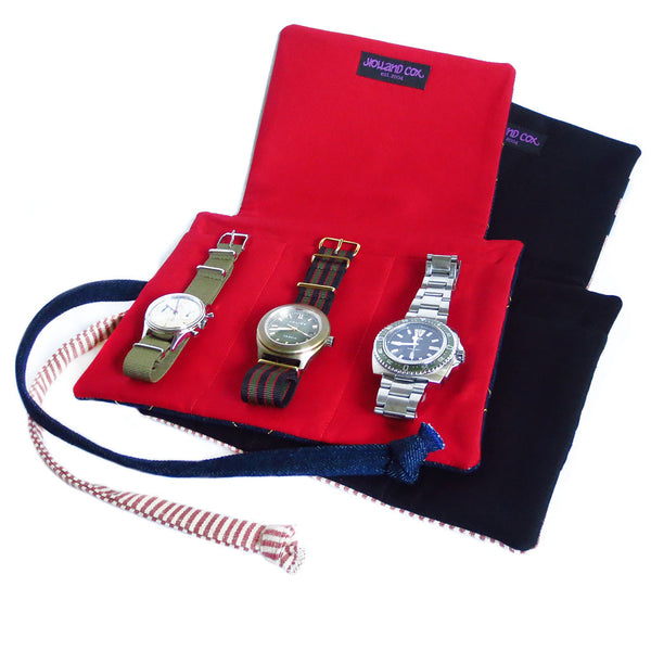 fabric watch roll with three generously sized pockets and padded lining