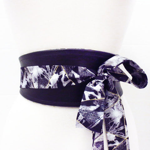 reversible wrap belt in black vinyl and black and gray cotton print, with long ties to tie in a knot or bow in front or back