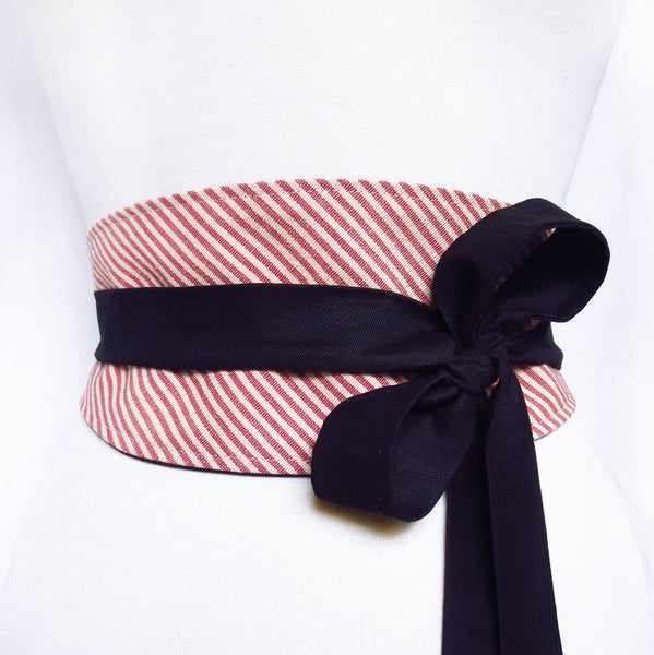 obi style belt made from red and white striped mattress ticking. Long ties are black cotton, wrapped and tied in a loose bow off to one side