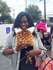 Evengelical Church Member of Rock of the Valley COGIC all smiles hugging her Warmkins