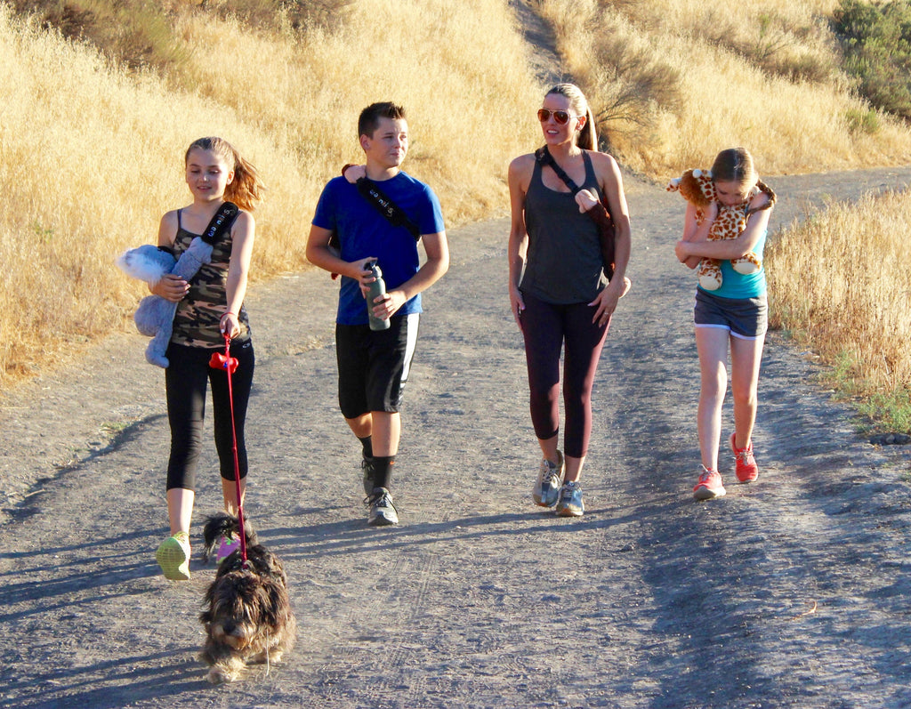 Warmkins Calabasas Family Hike Single Mother Warmkins Founder with three children and dog hike using Warmkins Therapeutic Weighted Sensory Plush Stuffed Animals as Backpacks, Los Angeles California