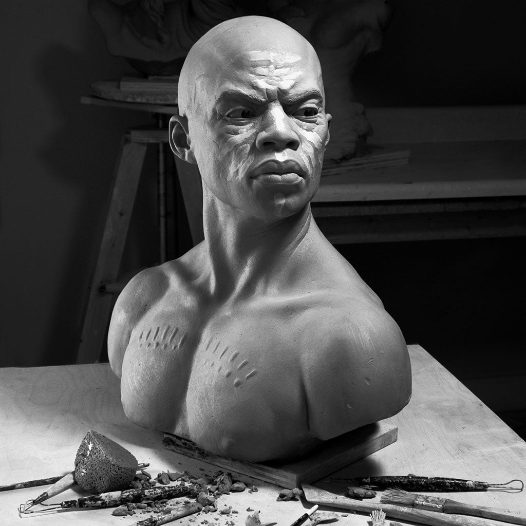 In progress clay sculpture of Zimbabwe warrior in Philippe Faraut studio