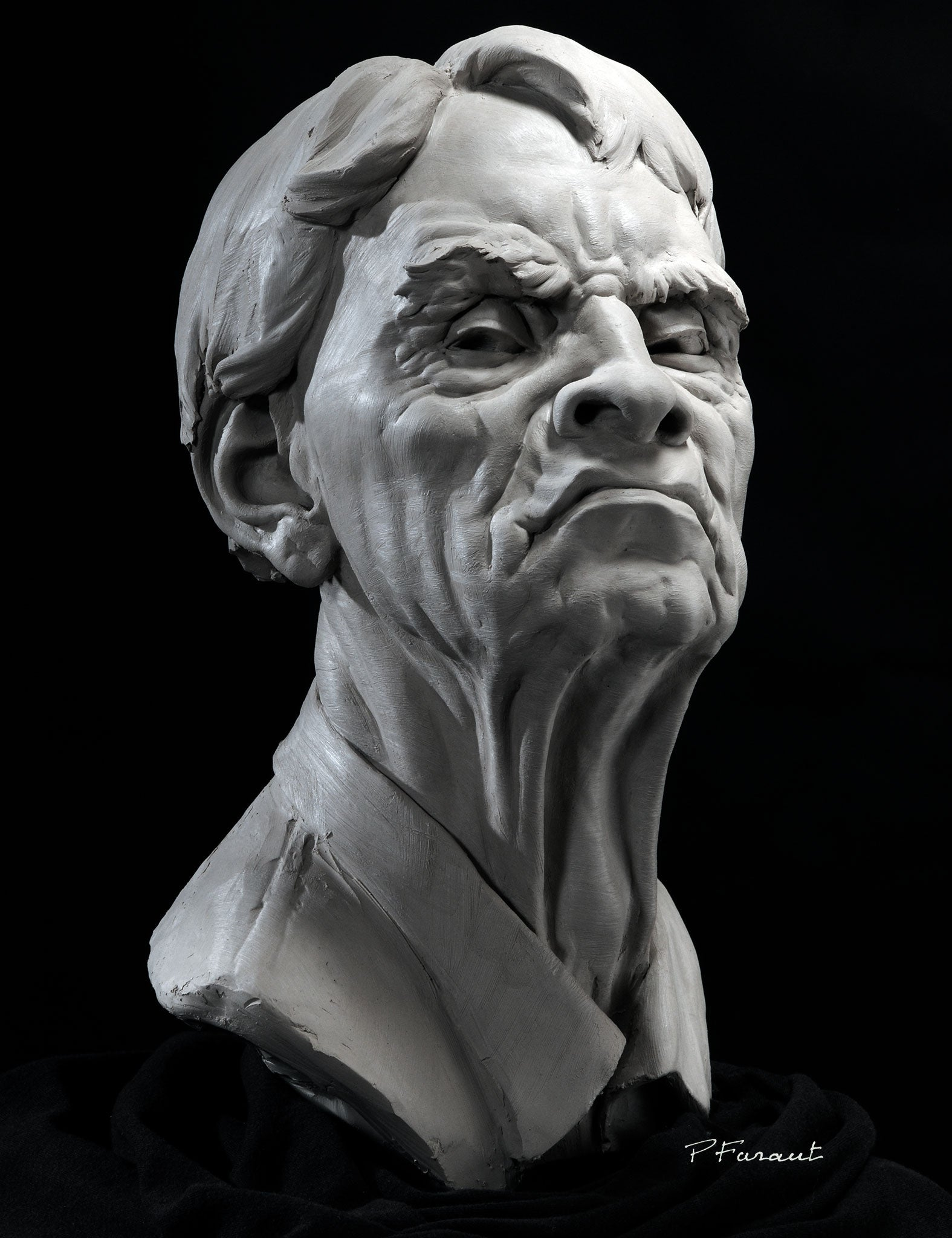 Clay portrait sculpture of an art critic with expression of disdain by Philippe Faraut