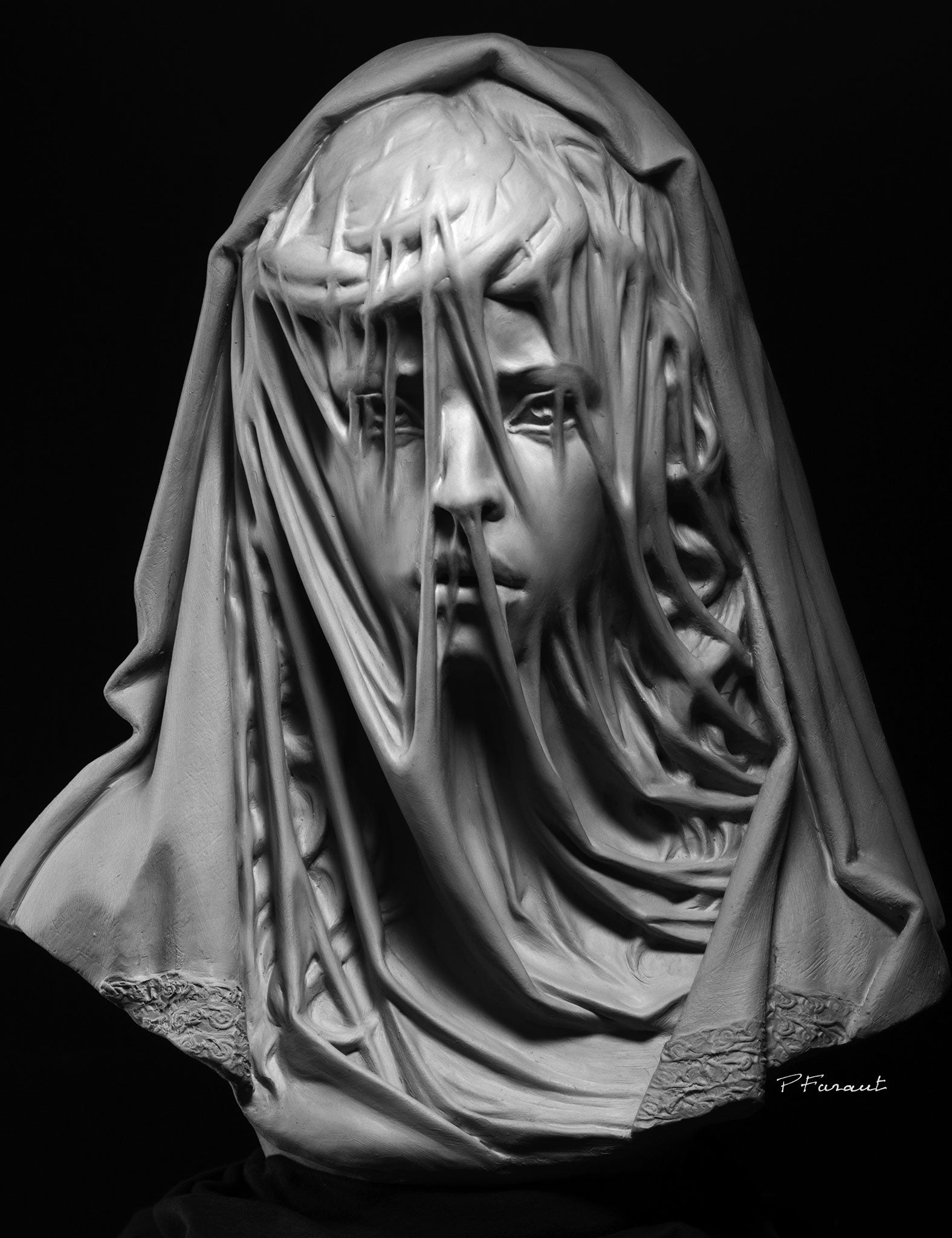 sculpture of child with translucent veil