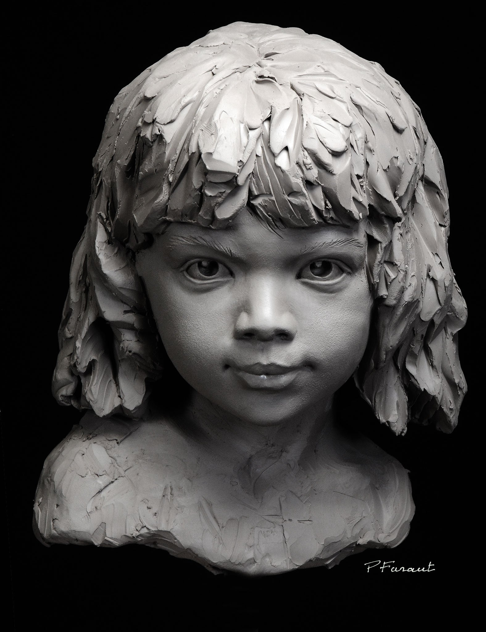 Stylized clay portrait sculpture of a little girl by artist Philippe Faraut