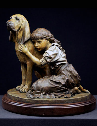 Bronze sculpture of bloodhound dog with little girl by Philippe Faraut