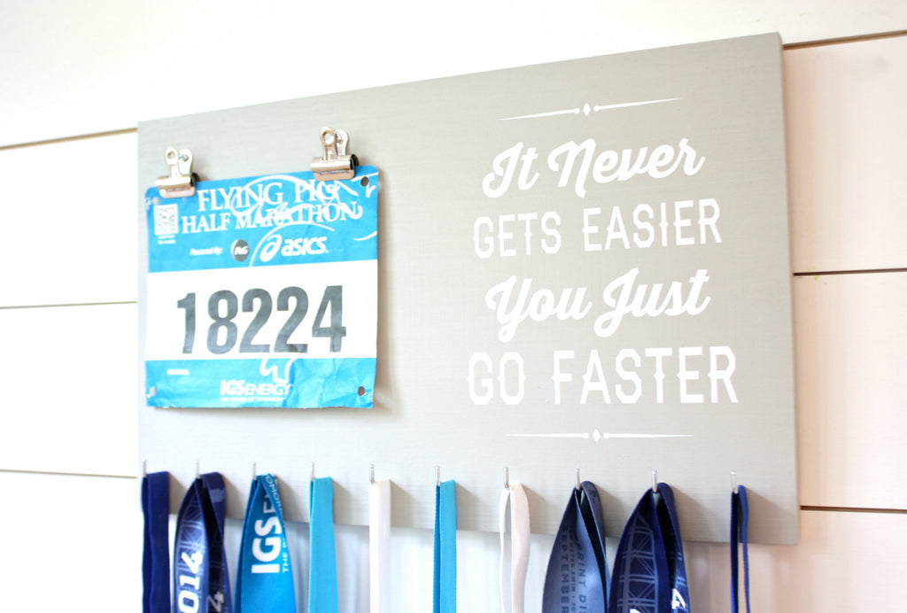 Medal Holder - It Never Gets Easier You Just Go Faster - Running / Cycling / Triathlon / Track / Cross Country - York Sign Shop - 1