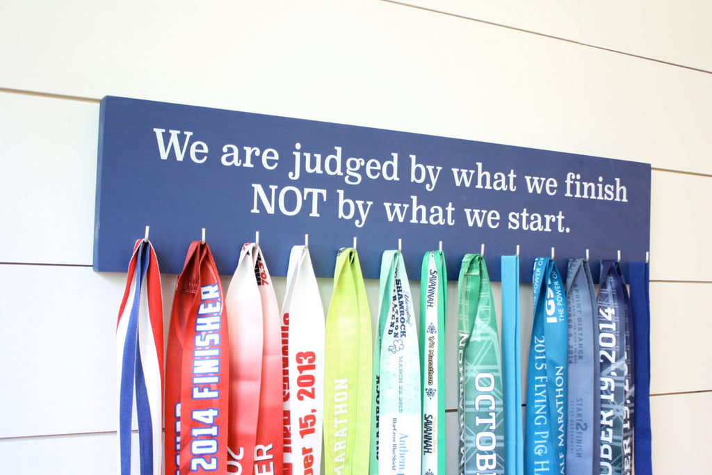 Medal Display - We are judged by what we finish NOT by what we start. - Large - Running / Triathlon / Ultra / Obstacle Race - York Sign Shop - 1