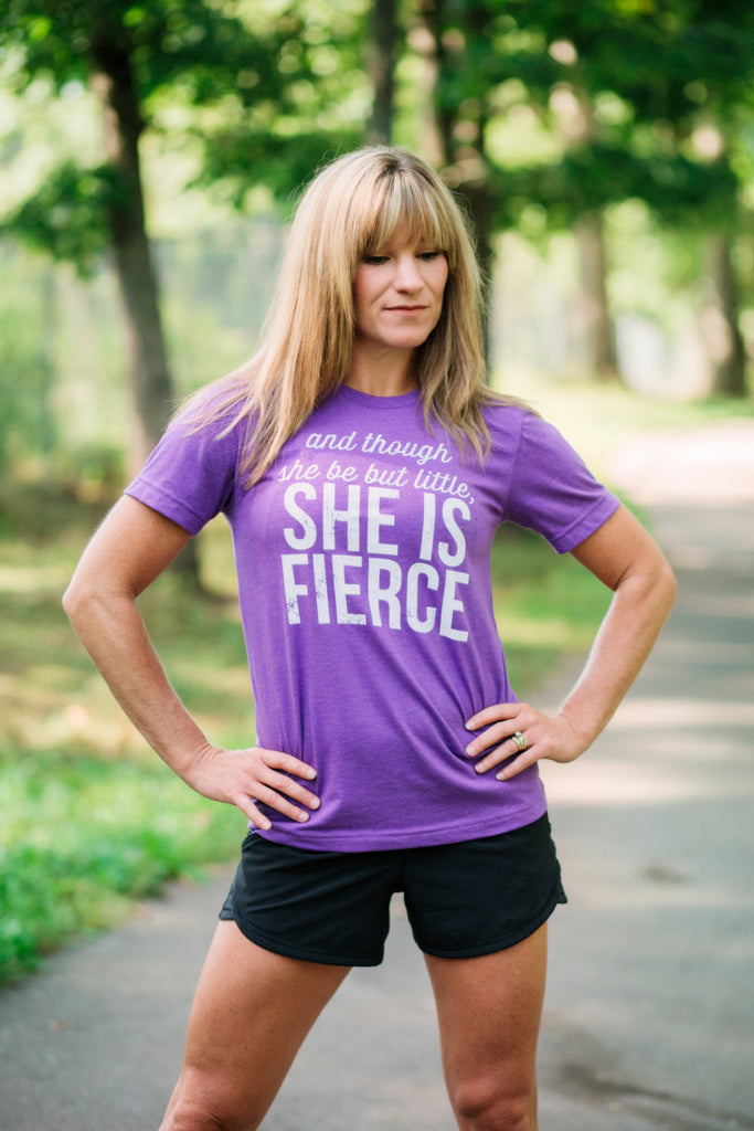 Women's T-shirt - And though she be but little. She is Fierce. Running Workout Gymnastics Cheer Dance Softball Soccer Swim Track Crossfit - York Sign Shop - 1