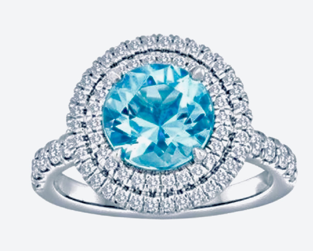 Ladies Platinum Ring, set with Aquamarine And Double Diamond Halo