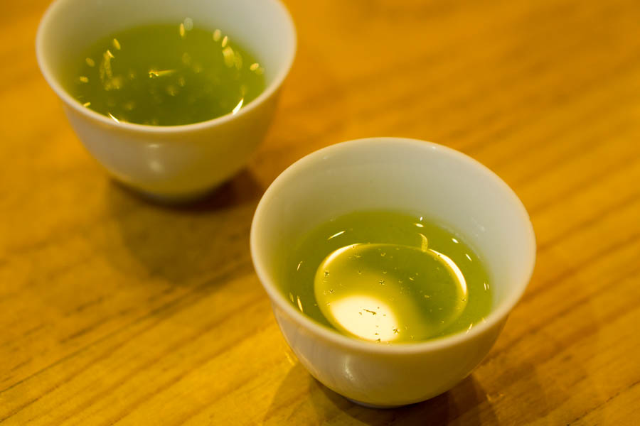 What looks dusts on the surface of green tea is...