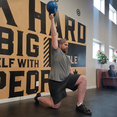 Half-Kneeling Bottoms-up kettlebell press