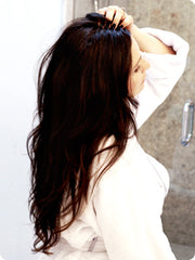 Woman with long hair, now finished shower using PonyDry