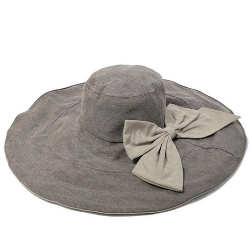 Ultra Wide Rolled Brim Hat With Decorative Bow