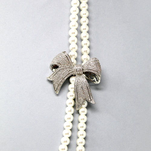 Cubic Zirconia Pave Bow With Double Layered Pearl Beaded Long Necklace