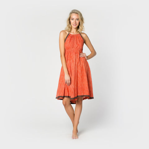 Photo of the front of a sleeveless coral skirt dress from Letarte.  Letarte sells dresses, bikinis, swimwear, cover-ups and other resort fashions.
